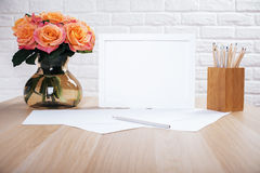 Roses, blank frame and stationery Royalty Free Stock Photos