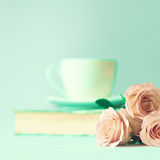 Roses and book Stock Images
