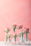 Roses in bottles Royalty Free Stock Photography