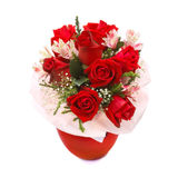 Roses bouquet. In red vase isolated on white background Royalty Free Stock Image