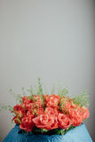 Roses bouquet on grey background with copy-space Stock Images