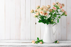 Roses bouquet in jug Royalty Free Stock Image