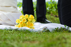 Roses bouquet  lying in grass on wedding ceremony Royalty Free Stock Photos