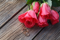 Roses bouquet on old wooden table Stock Image