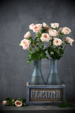 Roses bouquet in rustic vase Royalty Free Stock Photos