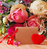 Roses bouquet and Valentine's Day card. Stock Photos