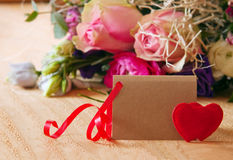Roses bouquet and Valentine's Day card. Royalty Free Stock Photography