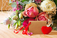 Roses bouquet and Valentine's Day card. Stock Photo
