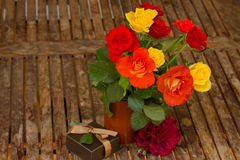 Roses bouquet on wooden table Stock Image