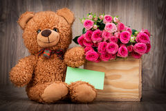 Roses in the box and a teddy bear Royalty Free Stock Photos