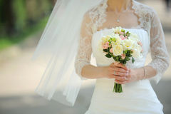 Roses in Bride's Hands Royalty Free Stock Images