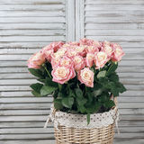 Roses bunch in basket Stock Photo
