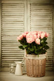 Roses bunch in basket Royalty Free Stock Photography