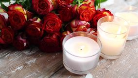 Roses and burning candles stock video footage