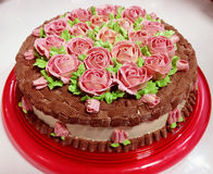 Roses cake. A white wedding cake with frosting roses Stock Image