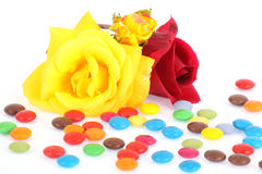 Roses and candies Stock Photos