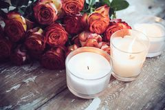 Roses and candles Stock Photos