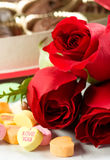 Roses and Candy Hearts Stock Image