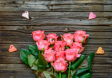 Roses at center of background with little hearts Stock Images