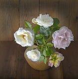 Roses in the ceramic vase Royalty Free Stock Photo
