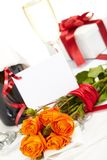 Roses and champagne Stock Images