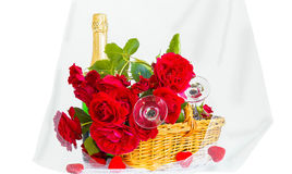 Roses and champagne on a white background Royalty Free Stock Photo