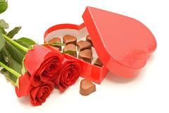 Roses and chocolate in a box. Red roses and heart shaped chocolate in red box - special event - isolated Royalty Free Stock Photos