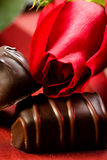 Roses and Chocolate Candy Stock Images