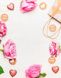 Roses , chocolate heart and shopping bag with love message cards on white wooden background Stock Images