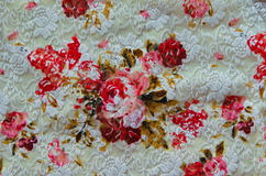 Roses on cloth fabric. Stock Photo
