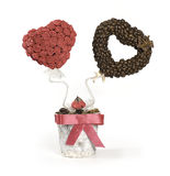 Roses and coffee beans topiary. Artificial topiary bouquet with roses and coffee beans over white background stock image