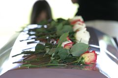 Roses on Coffin Royalty Free Stock Images