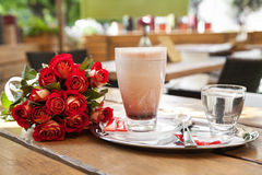 Roses with cup of cacao Stock Photography