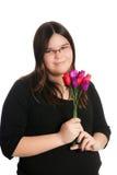 Roses de fixation de fille photo stock