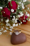Roses with Diamond Ring on Heart Chocolate Royalty Free Stock Photography