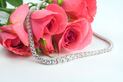 Roses and diamonds Royalty Free Stock Image