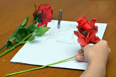 Roses and drawing for Valentine's event Royalty Free Stock Photography