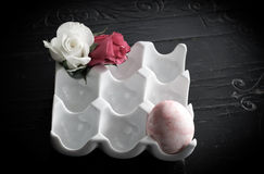 Roses and Egg in Porcelain Eggs Holder Stock Images
