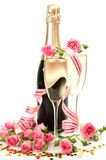 Roses et champagne roses Photographie stock