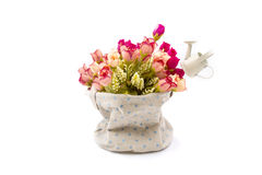 Roses in fabric vase on white Royalty Free Stock Photos