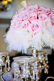 Roses & Feathers. Beautiful soft pink roses with white feathers as a wedding decoration for the table Stock Photography