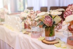 Roses on a festive wedding table in the restaurant. Wedding decoration stock photo