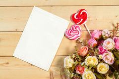 Roses flowers and empty tag for your text with heart shape candy Royalty Free Stock Images