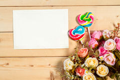 Roses flowers and empty tag for your text with heart shape candy Royalty Free Stock Image