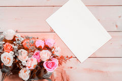 Roses flowers and empty tag for your text on wooden background Royalty Free Stock Photography