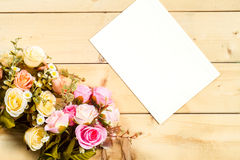 Roses flowers and empty tag for your text on wooden background Royalty Free Stock Images