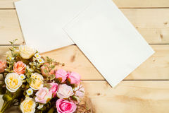 Roses flowers and empty tag for your text on wooden background Royalty Free Stock Photo