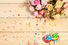 Roses flowers  with heart shape candy on wooden background Paste Royalty Free Stock Images