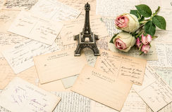 Roses, french postcards and souvenir Eiffel Tower Paris. Roses, antique french postcards and souvenir Eiffel Tower from Paris. nostalgic romantic background Royalty Free Stock Photo