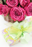Roses and gift Stock Images